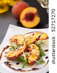 Closeup of grilled peaches salad with Parmesan cheese and roasted pine nuts. Balsamic vinegar sauce. - stock photo