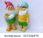Two Garden Gnomes  Against A...