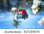 toy car on a fir tree branch in ... | Shutterstock . vector #527255074