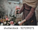 Girl Making A Bouquet Of Roses