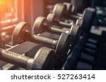 rows of dumbbells in the gym... | Shutterstock . vector #527263414