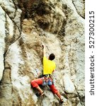 A Rock Climber Rappelling Past...