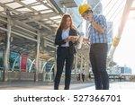 young engineers looking tablet...   Shutterstock . vector #527366701
