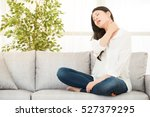young woman sitting on sofa... | Shutterstock . vector #527379295