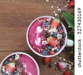 Small photo of acai berry smoothie a powerful superfood bowls, top view
