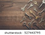 many different keys on brown... | Shutterstock . vector #527443795