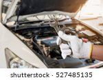 auto mechanic hand hold wrench... | Shutterstock . vector #527485135