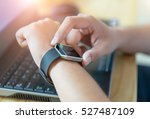 Small photo of Male hand with smart watch on wrist, wearable watch and technology computer for communication.