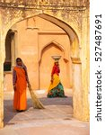Small photo of AMBER, INDIA - NOVEMBER 13: Unidentified women work in the fourth courtyard of Amber Fort on November 13, 2014 in Amber, India. Amber Fort is the main tourist attraction in the Jaipur area.