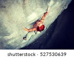 a rock climber rappelling past... | Shutterstock . vector #527530639