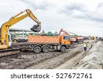 Yellow Excavator Is Filling A...