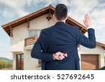 Back View Of Male Realtor With...