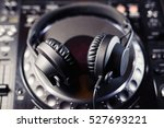 big black bass headphones on cd ... | Shutterstock . vector #527693221
