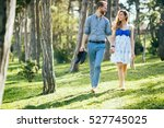 couple enjoying romantic walk...   Shutterstock . vector #527745025