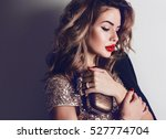 Stock photo close up portrait of elegant luxurious woman in trendy gold sequin party dress elegant wavy 527774704