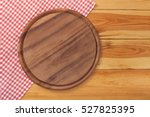 pizza board with napkin on... | Shutterstock . vector #527825395