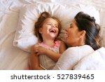 mother with her daughter enjoy... | Shutterstock . vector #527839465