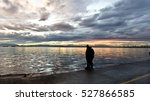 a couple by the sea at sundown | Shutterstock . vector #527866585