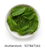 bowl of mint leaves isolated on ... | Shutterstock . vector #527867161