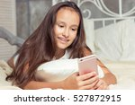 girl resting on the bed. happy... | Shutterstock . vector #527872915