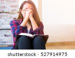Woman Praying On Holy Bible In...