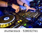 dj mixes the track in the... | Shutterstock . vector #528032761