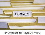 commit word on card index paper | Shutterstock . vector #528047497