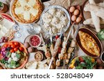 a lot of food on the table....   Shutterstock . vector #528048049