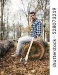 man with axe in the forest   Shutterstock . vector #528073219