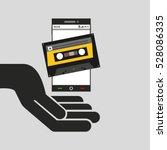 hand mobile phone cassette... | Shutterstock .eps vector #528086335