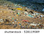 beach polluted with plastic... | Shutterstock . vector #528119089
