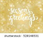 handdrawn lettering season's... | Shutterstock .eps vector #528148531