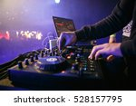 Small photo of MOSCOW - 30 NOVEMBER,2016: Party dj mix music.Digital midi turntable controller at hip hop party on stage in night club.Hands of DJ play show mixing tracks on concert in nightclub.Party dj on concert