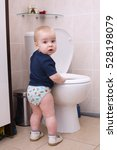 little boy looks in the toilet | Shutterstock . vector #528198079