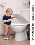 little boy looks in the toilet | Shutterstock . vector #528198091