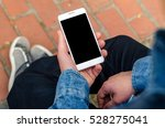 close up white mobile phone in...   Shutterstock . vector #528275041