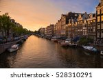 Stock photo evening amsterdam sunset in amsterdam beautiful amsterdam a beautiful sunset cityscape sunset 528310291