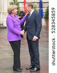 Small photo of KRAKOW, POLAND - JUNE 04, 2009: 20th Anniversary of the collapse of Communism in Central Europe o/p Polish Prime Minister Donald Tusk and Chancellor of Germany Angela Merkel