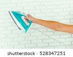 closeup of woman ironing... | Shutterstock . vector #528347251
