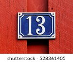 Number Thirteen Sign On A Red...