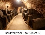 Corridor in winery with old wine cask - stock photo
