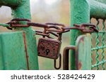 Rusty Lock Keeping A Fence...