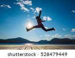 girl jumping in the sun on the... | Shutterstock . vector #528479449
