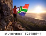 girl holding a south african... | Shutterstock . vector #528488944
