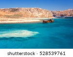 rusting shipwreck at the seaside | Shutterstock . vector #528539761