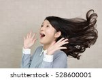 surprised asian woman   Shutterstock . vector #528600001