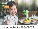 cute asian child eating... | Shutterstock . vector #528600391