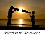 Small photo of Silhouette man and woman with bullhorn megaphone argument concept