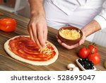 Male Hands Preparing Pizza At...