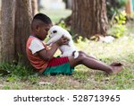Stock photo homeless children playing with puppies in the forrest 528713965